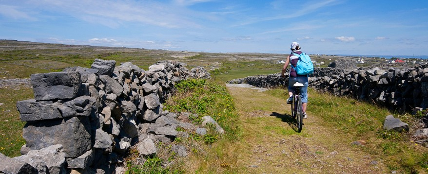 Cycling between stone walls.