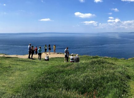 Tour group at the old head of Kinsale. Beyond the Glass Adventure Tour on Ireland's Wild Atlantic Way.