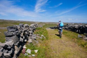 Cycling between stone walls on the Wild Atlantic Way